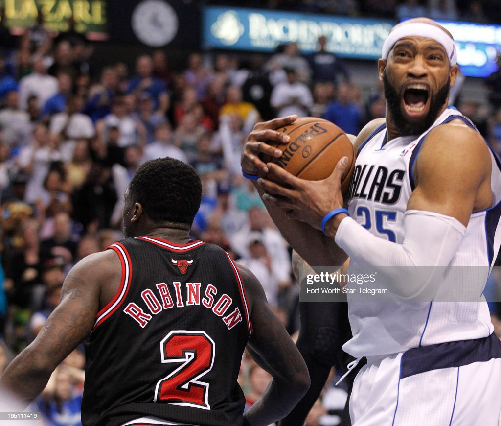 Dallas Mavericks' Vince Carter (25) reacts as he is called for a foul on the Chicago Bulls' Nate Robinson (2) in the fourth quarter at the American Airlines Center in Dallas, Texas, on Saturday, March 30, 2013. Dallas won, 100-98.