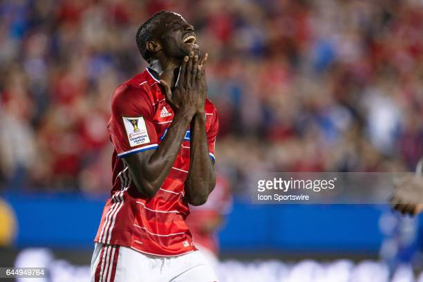 Dallas midfielder Roland Lamah reacts after missing the target with a shot during the CONCACAF Champions League Quarterfinal match between CD Arabe...