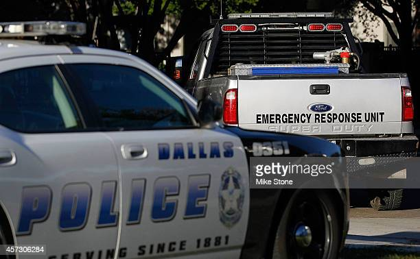 Dallas police car and an emergency response vehicle sit in the parking lot at the The Village Bend East apartment complex where a second health care...