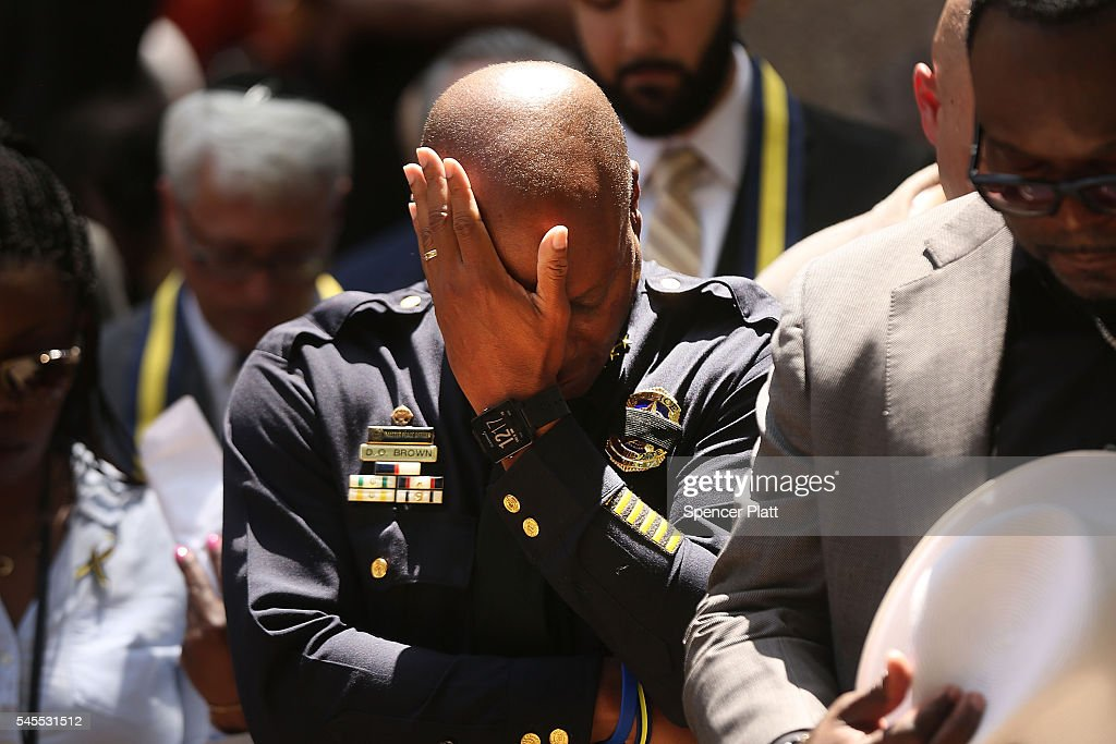 Dallas Police Chief David Brown pauses at a prayer vigil following the deaths of five police officers last night during a Black Live Matter march on...