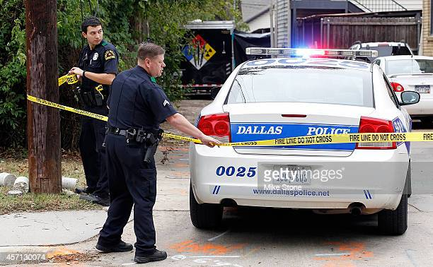 Dallas police setup a barrier after a hazmat vehicle entered the alley behind the apartment where a second person diagnosed with the Ebola virus...