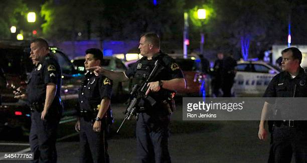 Dallas police stand watch near the scene where four Dallas police officers were shot and killed on July 7 2016 in Dallas Texas According to reports...