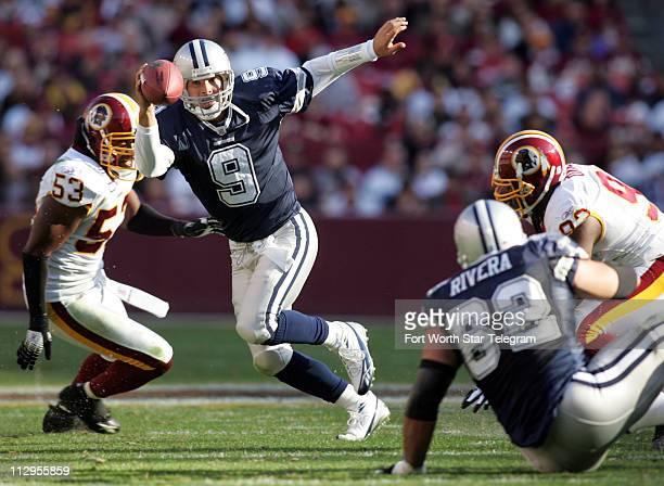 Dallas quarterback Tony Romo scrambles to pass as Washington defenders Marcus Washington and Phillip Daniels rush during the second quarter of the...