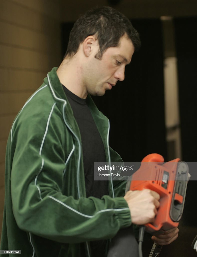 Dallas Stars' Bill Guerin makes some adjustments to his hockey stick before the game versus the Buffalo Sabres at the HSBC Arena in Buffalo NY...