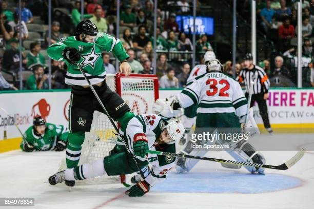 Dallas Stars center Jason Dickinson and Minnesota Wild defenseman Kyle Quincey run into each other in front of the net during the game between the...