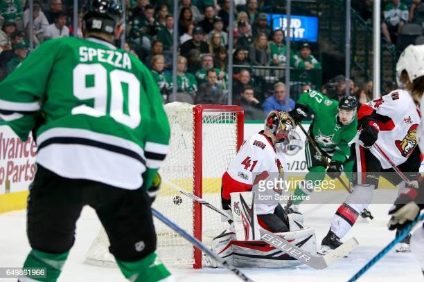 Dallas Stars Center Jason Spezza banks a shot off of Ottawa Senators Defenceman Mark Borowiecki and past Goalie Craig Anderson for a goal during the...