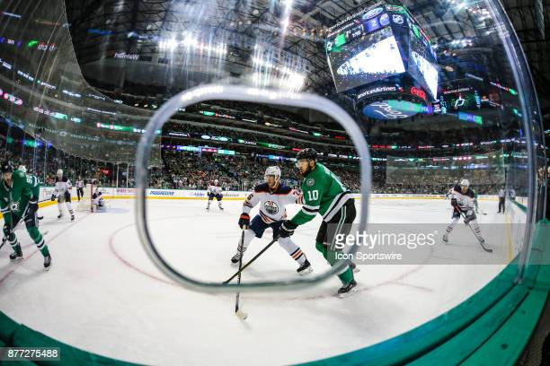 Dallas Stars center Martin Hanzal and Edmonton Oilers defenseman Darnell Nurse watch for the puck during the game between the Dallas Stars and the...