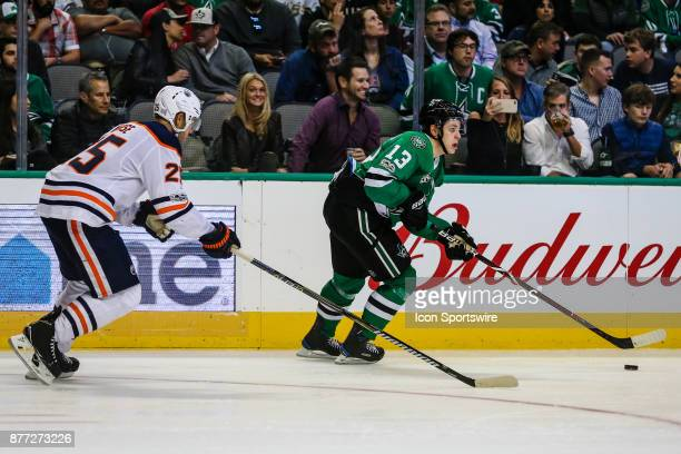 Dallas Stars center Mattias Janmark skates up the ice wit the puck as Edmonton Oilers defenseman Darnell Nurse chase him during the game between the...