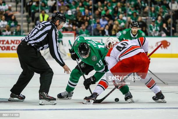 Dallas Stars center Radek Faksa and Carolina Hurricanes center Victor Rask battle for the puck after linesman Pierre Racicot drops the puck during...