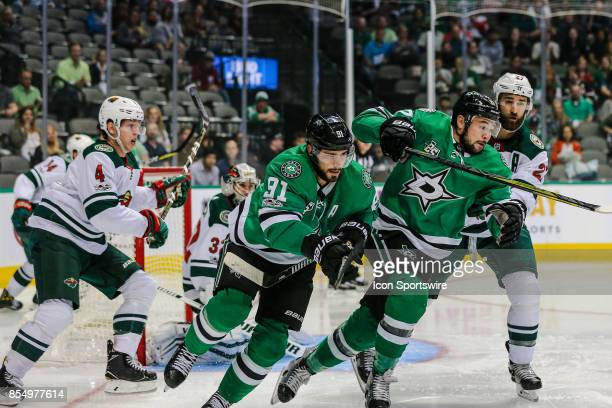 Dallas Stars center Tyler Seguin center Devin Shore and Minnesota Wild defenseman Kyle Quincey chase after the puck during the game between the...