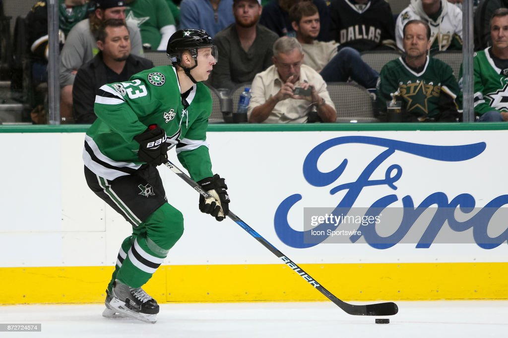 Dallas Stars Defenceman Esa Lindell (23) handles the puck during the NHL hockey game between the New York Islanders and Dallas Stars on November 10, 2017 at American Airlines Center in Dallas, TX.