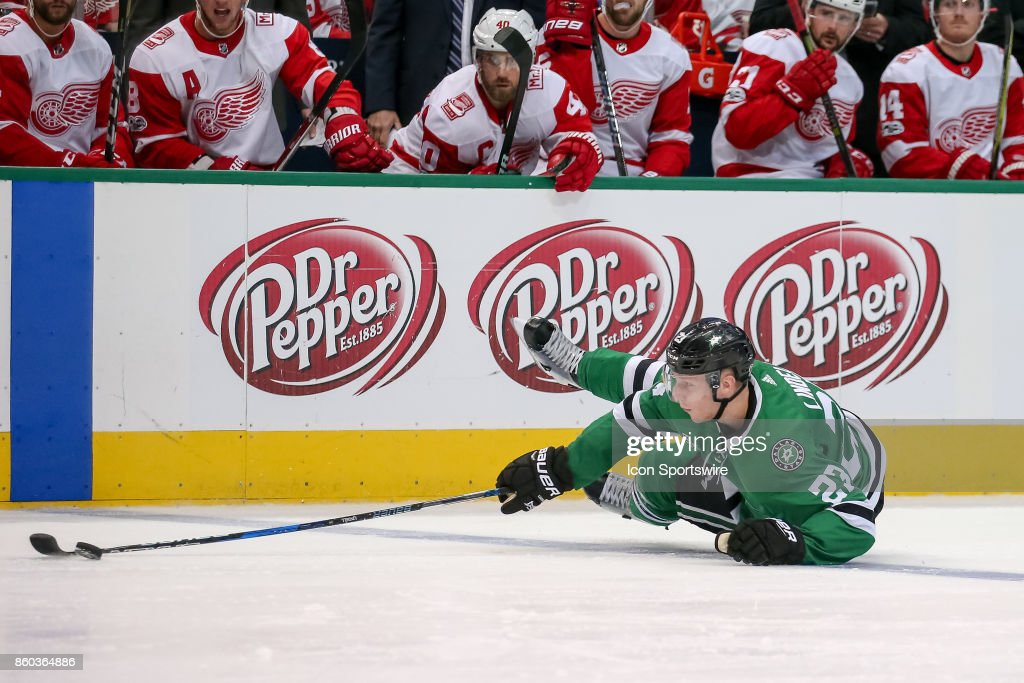 Dallas Stars Defenceman Esa Lindell (23) loses an edge but is able to keep the puck in the zone during the NHL game between the Detroit Red Wings and Dallas Stars on October 10, 2017 at the American Airlines Center in Dallas, TX.