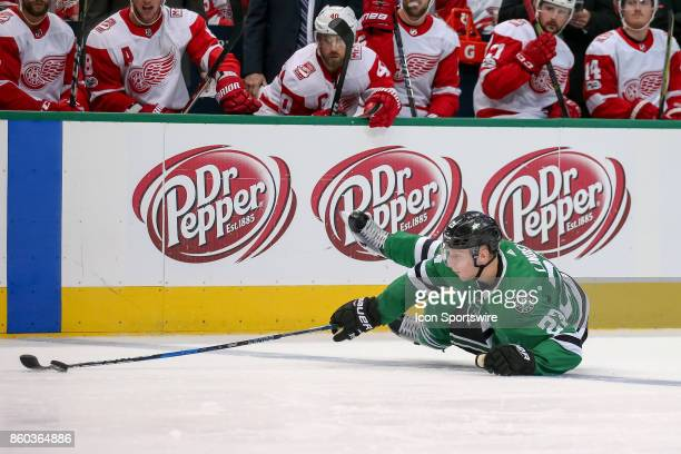 Dallas Stars Defenceman Esa Lindell loses an edge but is able to keep the puck in the zone during the NHL game between the Detroit Red Wings and...