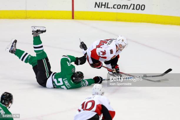 Dallas Stars Defenceman Esa Lindell trips Ottawa Senators Defenceman Mark Borowiecki during the NHL hockey game between the Ottawa Senators and...