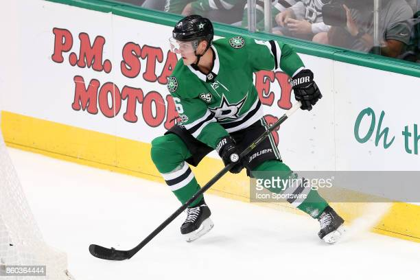 Dallas Stars Defenceman Julius Honka handles a puck behind the goal during the NHL game between the Detroit Red Wings and Dallas Stars on October 10...