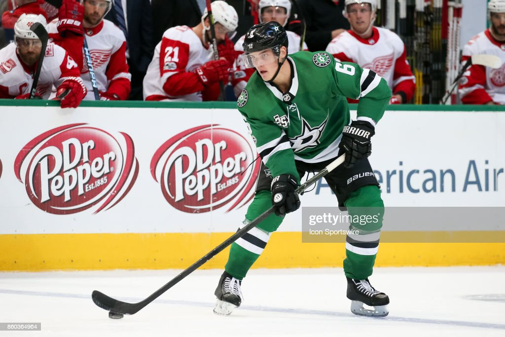 Dallas Stars Defenceman Julius Honka (6) handles the puck at the blue line during the NHL game between the Detroit Red Wings and Dallas Stars on October 10, 2017 at the American Airlines Center in Dallas, TX.