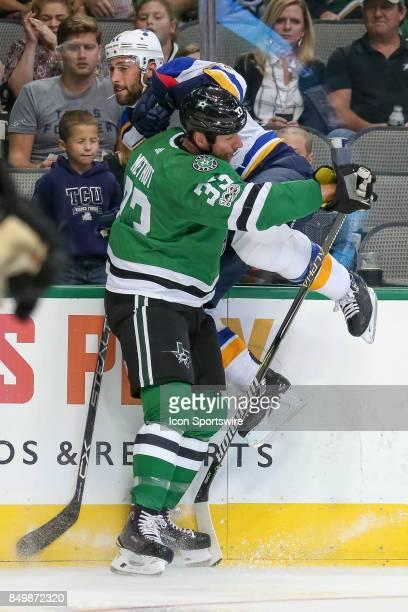 Dallas Stars defenseman Marc Methot hits St Louis Blues defenseman Robert Bortuzzo during the NHL game between the St Louis Blues and Dallas Stars on...