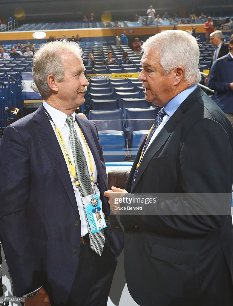 Dallas Stars General Manager <a gi-track='captionPersonalityLinkClicked' href=/galleries/search?phrase=Jim+Nill&family=editorial&specificpeople=2298874 ng-click='$event.stopPropagation()'>Jim Nill</a> talks with Florida Panthers General Manager <a gi-track='captionPersonalityLinkClicked' href=/galleries/search?phrase=Dale+Tallon&family=editorial&specificpeople=2163978 ng-click='$event.stopPropagation()'>Dale Tallon</a> during round one of the 2016 NHL Draft on June 24, 2016 in Buffalo, New York.