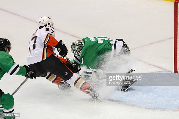 Dallas Stars Goalie Antti Niemi makes a save with snow being sprayed on him by Anaheim Ducks Left Wing Nick Ritchie during the NHL game between the...