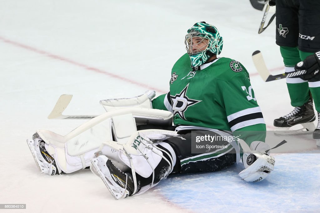 Dallas Stars Goalie Ben Bishop (30) makes a glove save during the NHL game between the Detroit Red Wings and Dallas Stars on October 10, 2017 at the American Airlines Center in Dallas, TX.