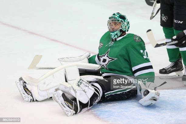 Dallas Stars Goalie Ben Bishop makes a glove save during the NHL game between the Detroit Red Wings and Dallas Stars on October 10 2017 at the...