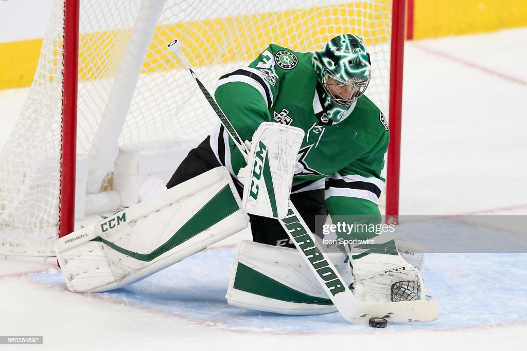 Dallas Stars Goalie Ben Bishop (30) makes a save during the NHL game between the Detroit Red Wings and Dallas Stars on October 10, 2017 at the American Airlines Center in Dallas, TX.