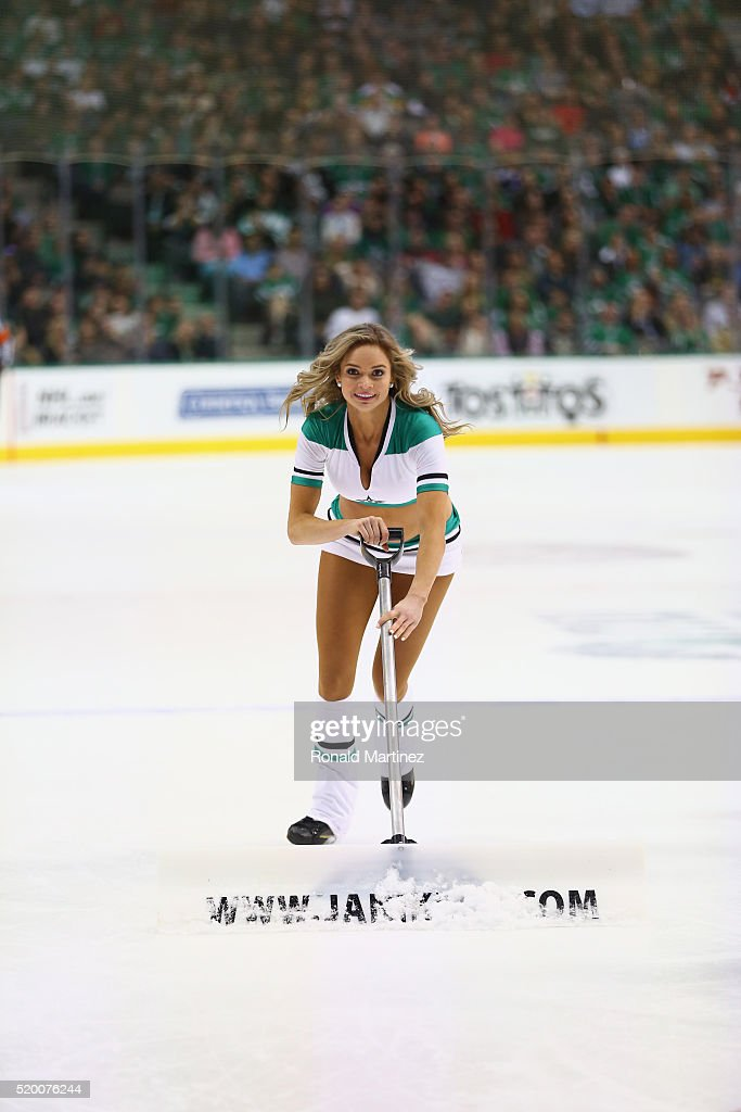 A Dallas Stars ice girl cleans the ice during a game between the Nashville Predators and the Dallas Stars at American Airlines Center on April 9, 2016 in Dallas, Texas.