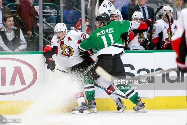 Dallas Stars Left Wing Curtis McKenzie hits Ottawa Senators Center Chris Kelly during the NHL hockey game between the Ottawa Senators and Dallas...