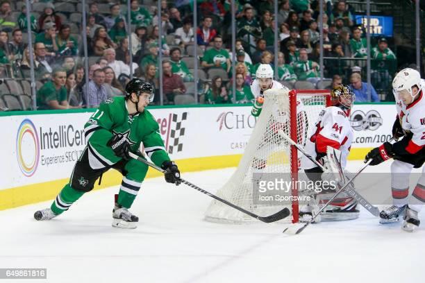 Dallas Stars Left Wing Curtis McKenzie tries a wrap around shot on Ottawa Senators Goalie Craig Anderson during the NHL hockey game between the...