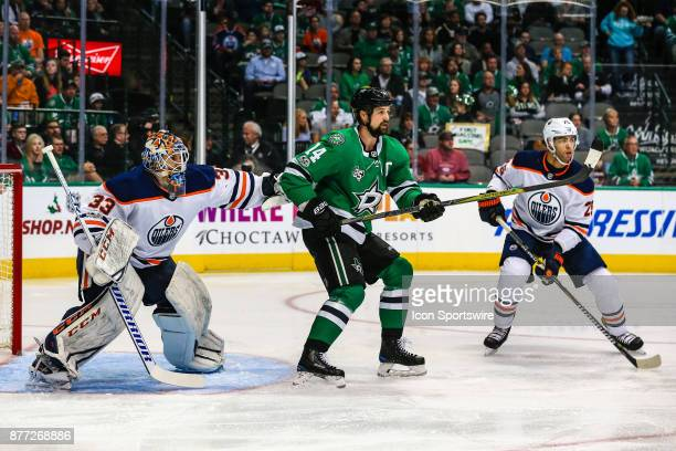 Dallas Stars left wing Jamie Benn and Edmonton Oilers center Leon Draisaitl set up in front of goalie Cam Talbot during the game between the Dallas...