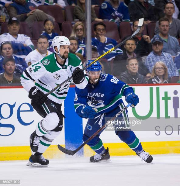 Dallas Stars Left Wing Jamie Benn battles with Vancouver Canucks Winger Sam Gagner in a NHL hockey game on October 30 at Rogers Arena in Vancouver BC...