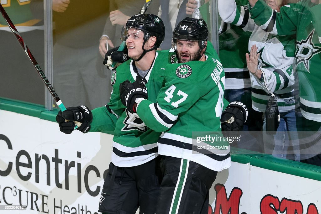 Dallas Stars Left Wing Mattias Janmark (13) celebrates his goal with Right Wing Alexander Radulov (47) during the NHL game between the Detroit Red Wings and Dallas Stars on October 10, 2017 at the American Airlines Center in Dallas, TX.