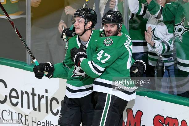 Dallas Stars Left Wing Mattias Janmark celebrates his goal with Right Wing Alexander Radulov during the NHL game between the Detroit Red Wings and...