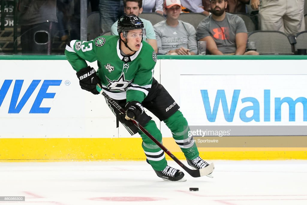 Dallas Stars Left Wing Mattias Janmark (13) looks to make a pass during the NHL game between the Detroit Red Wings and Dallas Stars on October 10, 2017 at the American Airlines Center in Dallas, TX.