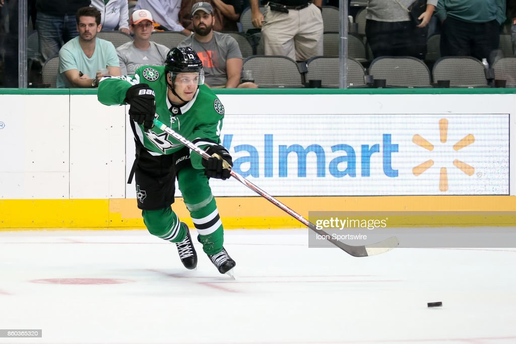 Dallas Stars Left Wing Mattias Janmark (13) makes a pass to setup the final goal of the NHL game between the Detroit Red Wings and Dallas Stars on October 10, 2017 at the American Airlines Center in Dallas, TX.