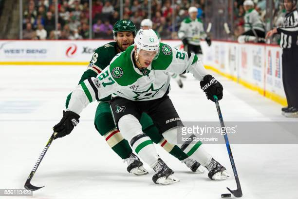 Dallas Stars right wing Adam Cracknell protects the puck from Minnesota Wild left wing Jason Zucker during the preseason game between the Dallas...
