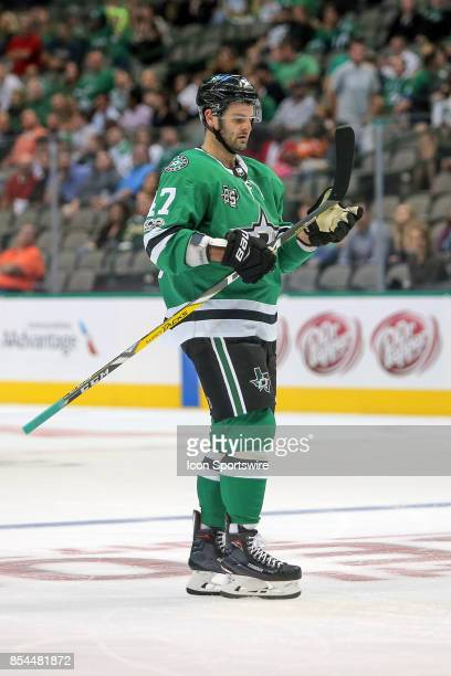 Dallas Stars right wing Alexander Radulov examines his stick during the NHL game between the Colorado Avalanche and the Dallas Stars on September 25...
