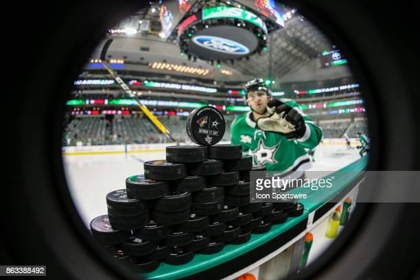 Dallas Stars right wing Alexander Radulov grabs souvenir game puck before the game between the Dallas Stars and the Arizona Coyotes on October 17...