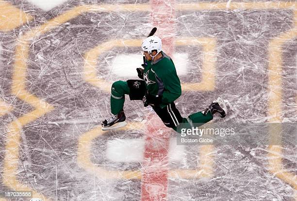 Dallas Stars Tyler Seguin stretches on the Bruins logo during practice at TD Garden in Boston Nov 4 2013