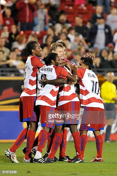 Dallas team members celebrate a goal scored by defender Ugo Ihemelu of FC Dallas at Pizza Hut Park on October 17 2009 in Frisco Texas