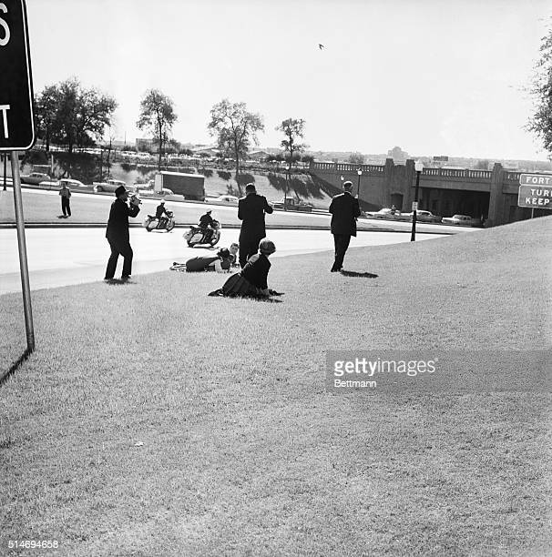 Dallas TXORIGINAL CAPTION READS Looking For Cover A newsreel cameraman stands at the left as spectators hug the ground moments after sniper's bullet...