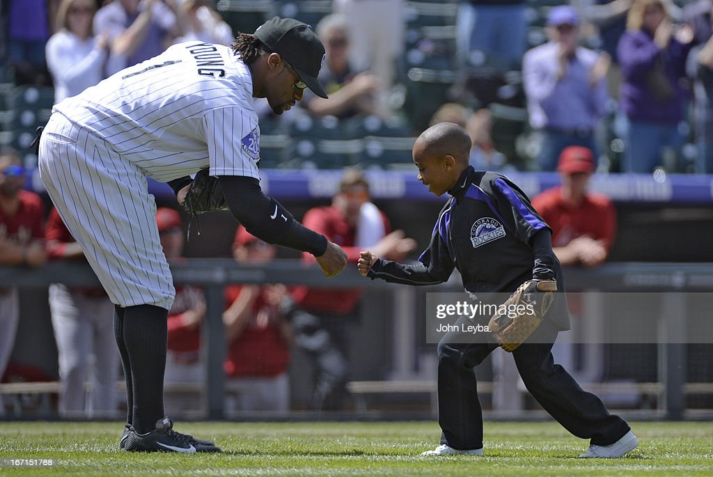 Dallas Young 6-years-old fist bumps his brother Eric Young Jr. after throwing out the first pitch prior to their game against the Arizona DiamondBacks April 21, 2013 at Coors Field.