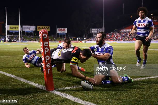 Dallin Watene Zelezniak of the Panthers scores a try in the corner during the round 21 NRL match between the Penrith Panthers and the Canterbury...