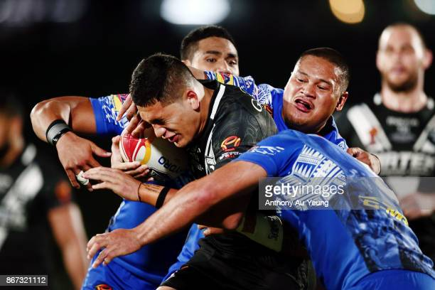 Dallin WateneZelezniak of the Kiwis is tackled by Joseph Leilua of Samoa during the 2017 Rugby League World Cup match between the New Zealand Kiwis...