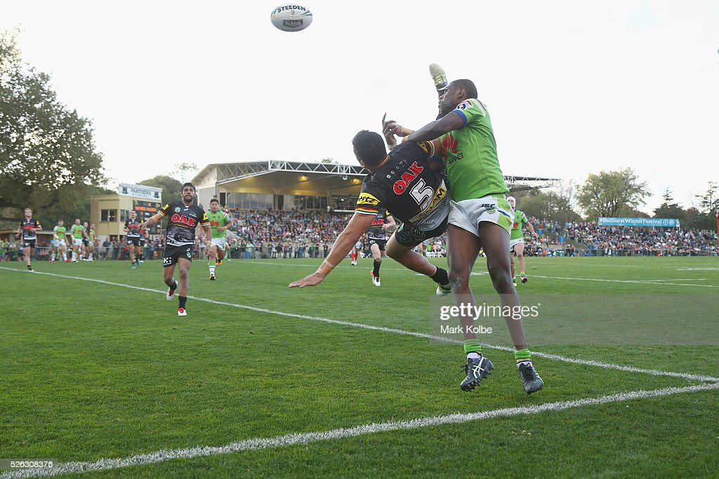 Dallin Watene-Zelezniak of the Panthers and Edrick Lee of the Raiders compete for the ball from a kick during the round nine NRL match between the Penrith Panthers and the Canberra Raiders at Carrington Park on April 30, 2016 in Bathurst, Australia.