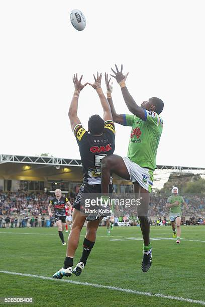 Dallin WateneZelezniak of the Panthers and Edrick Lee of the Raiders compete for the ball from a kick during the round nine NRL match between the...