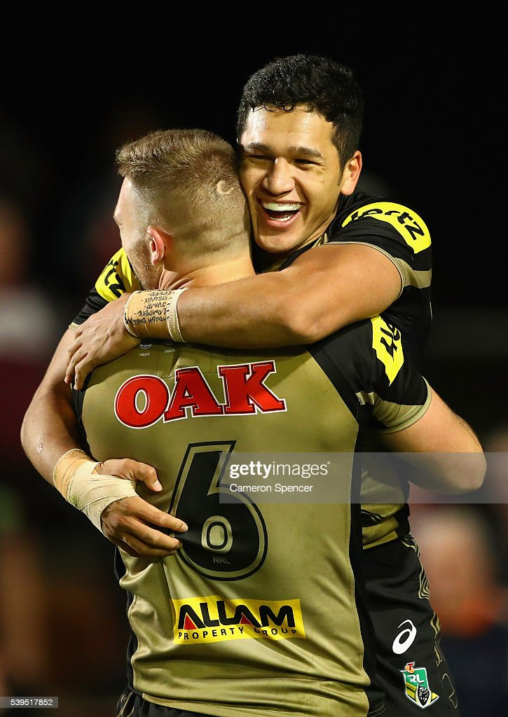 Dallin Watene-Zelezniak of the Panthers celebrates with team mate Bryce Cartwright after scoring a try during the round 14 NRL match between the Manly Sea Eagles and the Penrith Panthers at Brookvale Oval on June 12, 2016 in Sydney, Australia.