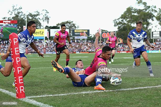 Dallin WateneZelezniak of the Panthers scores a try during the round one NRL match between the Penrith Panthers and the Canterbury Bulldogs at Pepper...