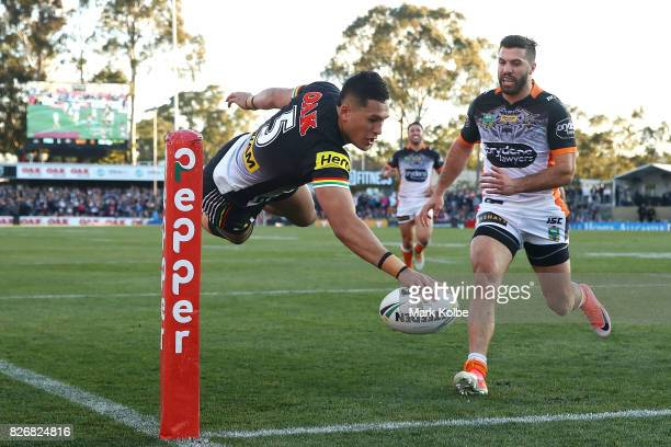 Dallin WateneZelezniak of the Panthers scores a try during the round 22 NRL match between the Penrith Panthers and the Wests Tigers at Pepper Stadium...