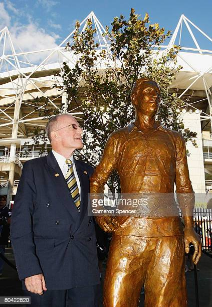 Dally Messenger III stands next to a sculpture of his grandfather Dally Messenger during an offical unveiling as part of the Basil Sellers Sculptures...